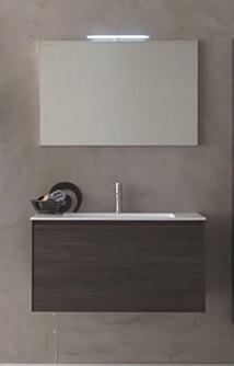 Light G113 Noce ScuroМебель для ванной<br>Novello Light G113  набор мебели для ванной комнаты. В комплекте: тумба подвесная с керамической раковиной G113, зеркало E371, светильник V885.  Столешница выполнена из материала Novcryl, обеспечивающего превосходную механическую и химическую стойкость и легкую чистку.<br>