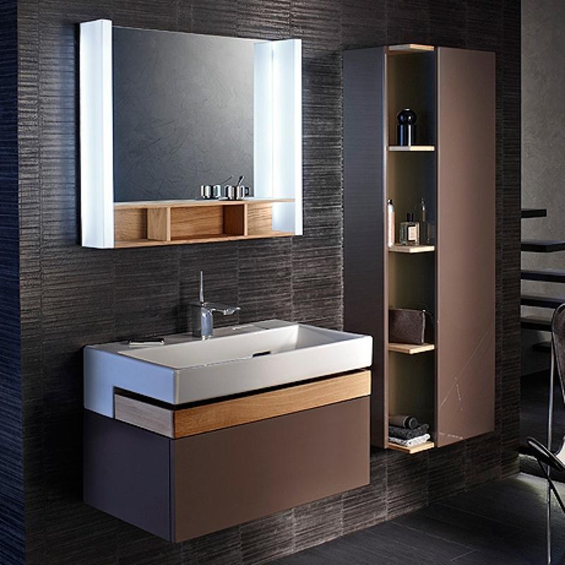 Terrace 100 подвесная Ледяной коричневыйМебель для ванной<br>Подвесная тумба под раковину Jacob Delafon Terrace 100 EB1187-N23 с двумя выдвижными ящиками.<br>Совмещает в себе элегантность и непревзойденную функциональность. Утонченный стиль тумбы дополнит большинство современных ванных комнат.<br>Изготовлена из МДФ/ЛДСП и покрыта глянцевым полиуретановым лаком высокого качества. Материалы устойчивы к выцветанию и предназначены для использования в помещениях с повышенной влажностью.<br>Два выдвижных ящика со встроенными доводчиками. Верхний ящик, изготовленный из цельного дерева, предназначен для хранения аксессуаров. Нижний ящик более глубокий и подойдет для хранения объемных предметов.<br>Мягкий и плавный ход ящиков с функцией Soft Close. Открываются по нажатию.<br>Цвет: ледяной коричневый.<br>Монтаж: подвесной.<br>В комплекте поставки: тумба под раковину.<br>