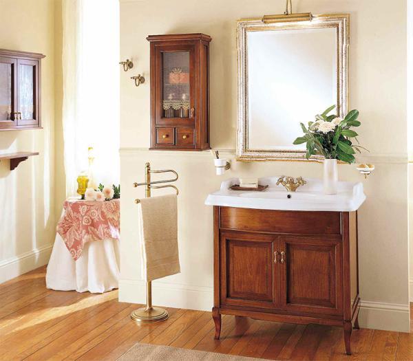 Victoria H0/7.DX Орех/БронзаМебель для ванной<br>Подвесной шкаф Labor Legno Victoria для ванной комнаты с одной левосторонней дверцей со стеклом и двумя ящиками. Цвет фасада орех, фурнитура бронза.<br>