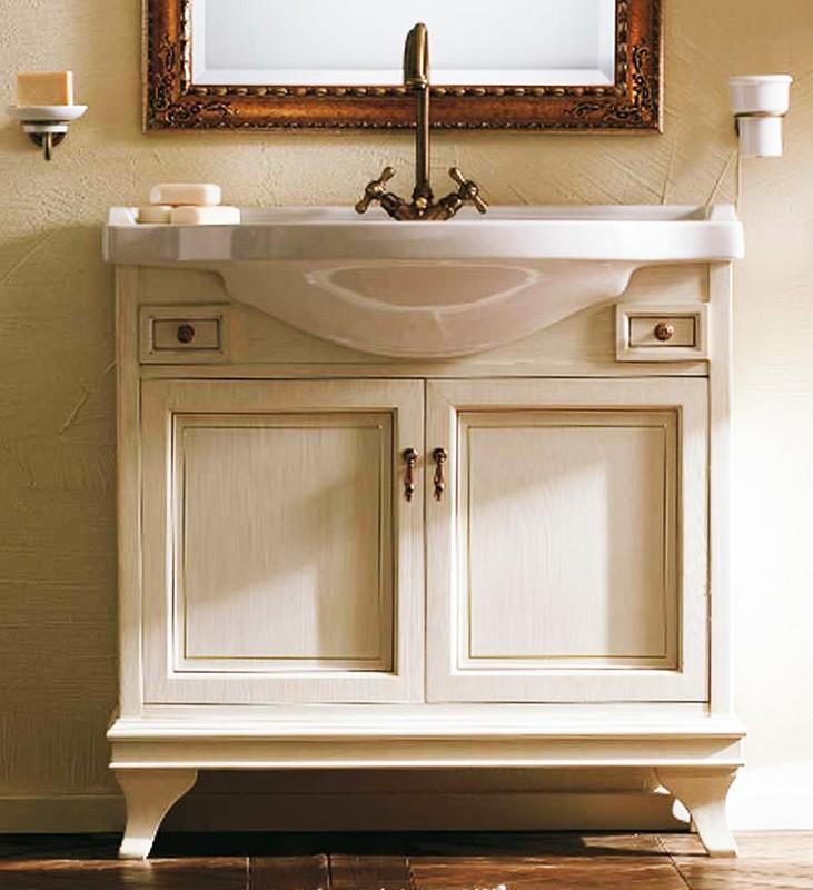Marriot 85 Белый с патиной/БронзаМебель для ванной<br>Мебель для ванной Labor Legno, тумба Marriot MPL85PAT с двумя распашными дверцами и двумя ящичками, а также с овальной раковиной MC85 с одним отверстием под смеситель 85x51 см. Фасад белый с патиной, фурнитура бронза, раковина белый.<br>