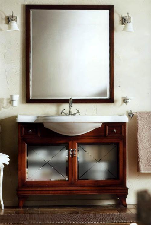 Marriot 105 Вишня/БронзаМебель для ванной<br>Мебель для ванной Labor Legno, тумба Marriot MPL105V с двумя распашными дверцами со стеклом и двумя ящичками, а также с овальной раковиной MC105 с одним отверстием под смеситель105x51 см. Фасад вишня, фурнитура бронза, раковина белый.<br>