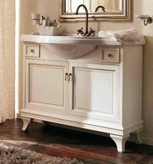 Marriot 105 Белый с патиной/БронзаМебель для ванной<br>Мебель для ванной Labor Legno, тумба Marriot MPL105PAT с двумя распашными дверцами и двумя ящичками, а также раковиной MC105 с одним отверстием под смеситель105x51 см. Фасад белый с патиной, фурнитура бронза, раковина белый.<br>