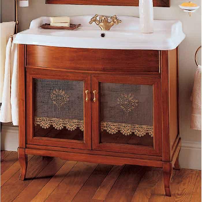 Victoria 90 Орех/бронзаМебель для ванной<br>Напольная база под раковину Labor Legno Victoria с двумя инкрустированными дверками со стеклом и прямоугольной раковиной 900x560 мм. Цвет орех, фурнитура бронза, раковина белый.<br>