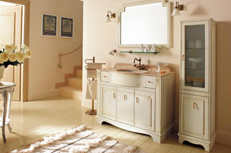 Royal 110  Белый с патиной/БронзаМебель для ванной<br>Комплект мебели Labor Legno Royal, база под раковину с 3 дверцами и 2 ящиками, топ для раковины с одним отверстием 1100х550х20 мм, раковина LAVSP 570 мм, зеркало 950х760 мм  и два светильника.<br>