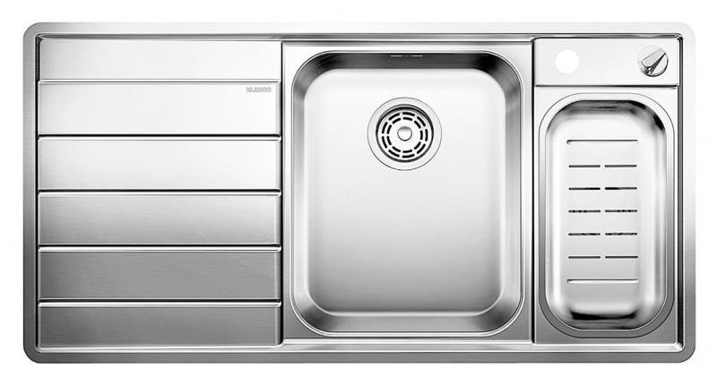 Axis II 6-S-IF 516529 Нержавеющая сталь с зеркальной полировкойКухонные мойки<br>Кухонная мойка Blanco Axis II 6-S-IF 516529 прямоугольная, 2 чаши, 1 крыло. Чаша большая по центру, маленькая справа. В чашу устанавливается многофункциональный коландер из нержавеющей стали. Глубина чаш 175/110 мм. Монтаж на столешнице или в один уровень со столешницей. 2 размеченных отверстия для смесителя и автоматического клапана. Отводная арматура с автоматическим клапаном 3 1/2 для большой чаши, отводная арматура с корзинчатым вентилем 1 1/2 для маленькой чаши. Для установки в шкаф шириной от 600 мм. Профиль для вертикального хранения разделочной доски. Мойка сделана из нового типа нержавеющей стали, плоский кант, система против царапин, система против грязи и налета на поверхности мойки. Доска разделочная скользящая из безопасного стекла.<br>