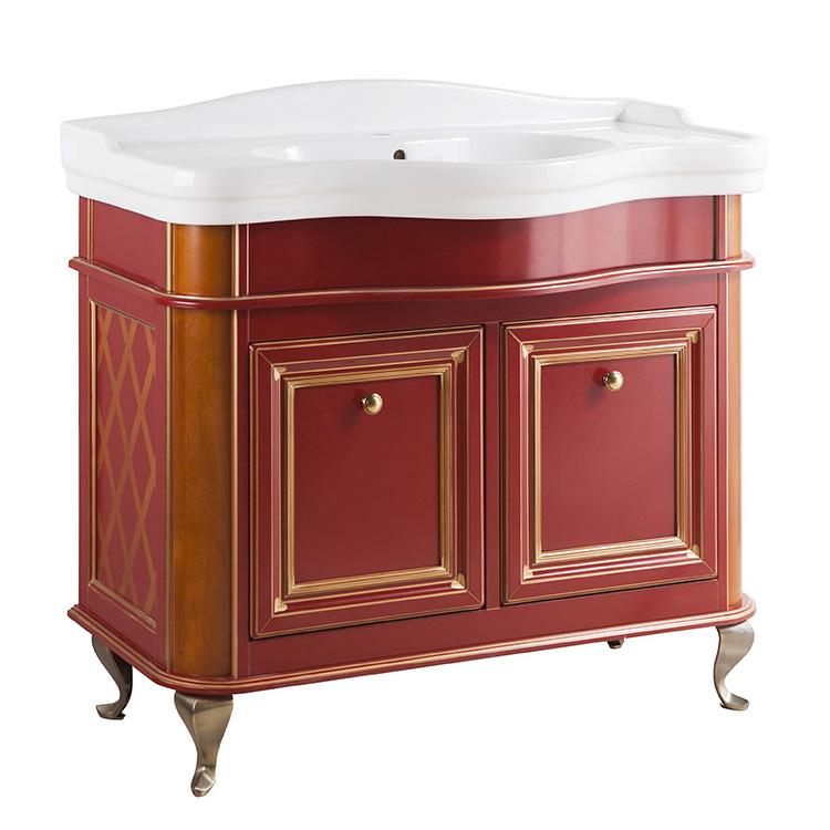 Виво 100 ROSSO NOCE (B 018)Мебель для ванной<br>Мебель для ванной Каприго Виво 100. В стоимость входит тумба напольная под умывальник. С двумя дверцами, на ножках. Размеры – 1018x812x487 мм. Отделка – ROSSO NOCE. Варианты мебельных ручек – В 15, В 16 В, В 17. Размер тумбы с раковиной: 910x939x545 мм.<br>
