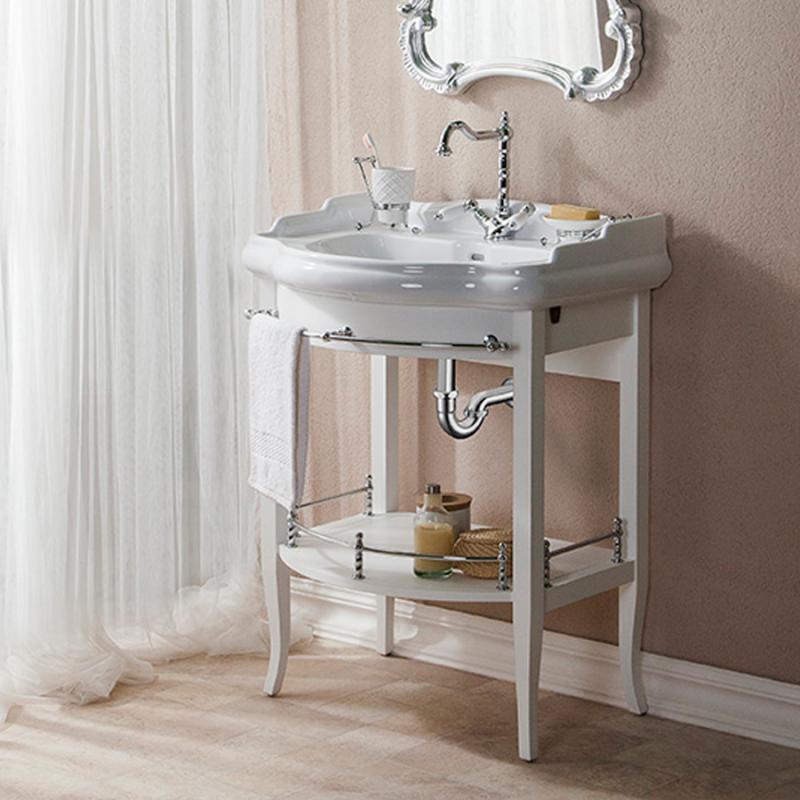 Треви 70 NOCE ANTICO (B 009)Мебель дл ванной<br>Консоль под раковину Каприго Треви 70 выполненна в популрном классическом стиле. Высота – 825 мм. Глубина – 535 мм. Отделка – NOCE ANTICO. Размер тумбы с раковиной 745x958x545 мм.<br>