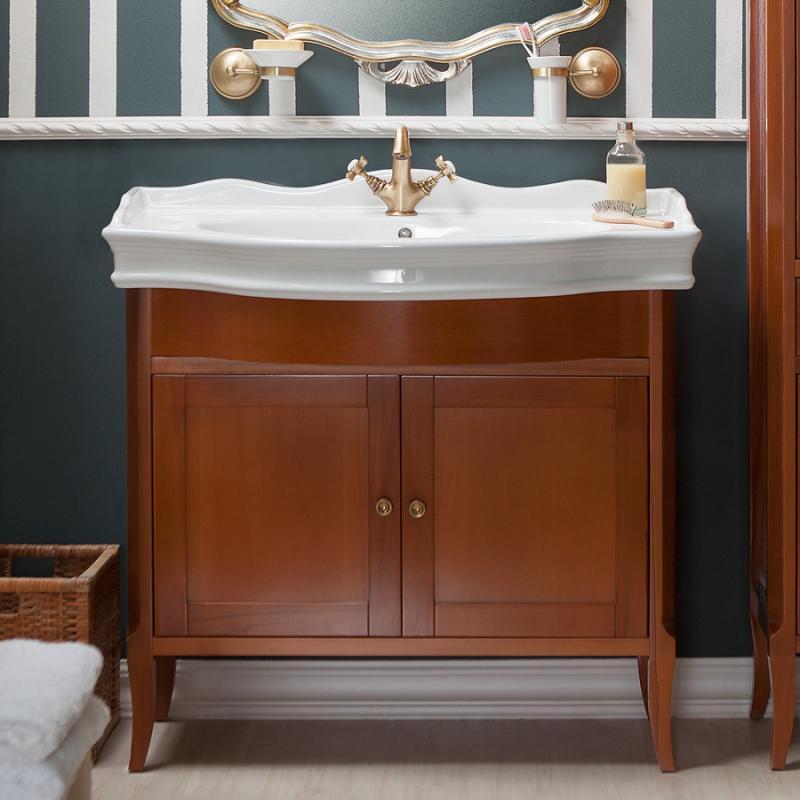 Валенсия 100 ONTANO (B 009)Мебель для ванной<br>Мебель для ванной Каприго Валенсия 100. В стоимость входит тумба напольная под умывальник. С двумя распашными дверцами. Размеры – 930x826x515 мм. Отделка – ONTANO. Варианты мебельных ручек – В 08, В 13. Размер тумбы с раковиной 1000x996x525 мм.<br>