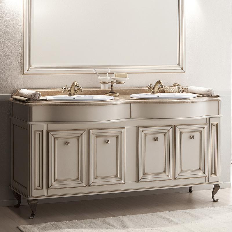 Фреско 160 двойная Bianco oro caldo (B 017)Мебель для ванной<br>Тумба под раковину Caprigo Фреско 160 двойная без столешницы и раковины.<br>Цена указана за  тумбу, все дополнительное оборудование приобретаться отдельно.<br>Габариты – 1602x902x633 мм.<br>Отделка – Bianco oro caldo. <br>Итальянский классицизм – непреходящий стиль, который постоянно находит себе новых поклонников. Опираясь на античное наследие, в нем всегда живет гармония. Симметрия форм и элегантность линий мебели Фреско никого не оставят равнодушным.<br>