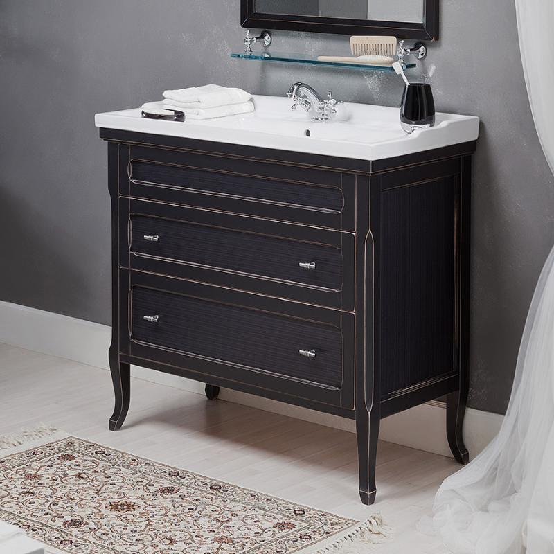 Гарда 100 NOCE ANTICO (B 009)Мебель для ванной<br>Мебель для ванной Каприго Гарда 100. В стоимость входит тумба напольная под раковину. С двумя выдвижными ящиками. Размеры – 1005х845х455 мм. Отделка – NOCE ANTICO. Варианты мебельных ручек – В 08, В 16В, В 17. Размер тумбы с раковиной 1020x950x465 мм.<br>