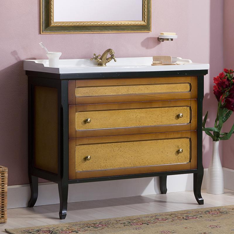 Гарда 120 NOCE ANTICO (B 009)Мебель для ванной<br>Мебель для ванной Каприго Гарда 120. В стоимость входит тумба напольная под раковину. С двумя выдвижными ящиками. Размеры – 1186х845х455 мм. Отделка – NOCE ANTICO. Варианты мебельных ручек – В 08, В 16В, В 17. Размер тумбы с раковиной 1210x929x465 мм.<br>