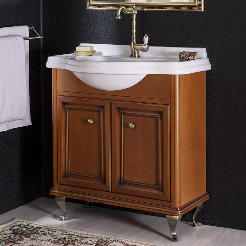 Равенна 80 NOCE ANTICO (B 009)Мебель для ванной<br>Мебель для ванной Каприго Равенна 80. В стоимость входит тумба напольная под раковину. Размеры – 810x935x479 мм. Отделка – NOCE ANTICO. Варианты мебельных ручек – В 08, В 13, В 15. Размер тумбы с раковиной 810x935x479 мм.<br>