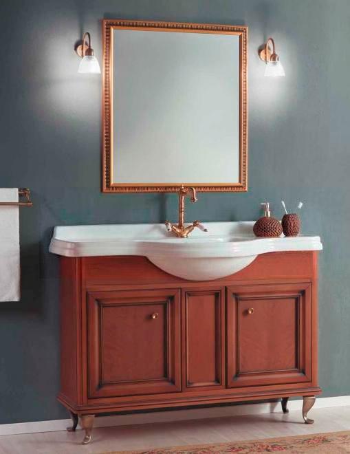 Равенна 100 NOCE ANTICO (B 009)Мебель для ванной<br>Мебель для ванной Каприго Равенна 100. В стоимость входит тумба напольная под раковину. Размеры – 1204x944x497 мм. Отделка – NOCE ANTICO. Варианты мебельных ручек – В 08, В 13, В 15. Размер тумбы с раковиной 1024x944x507 мм.<br>