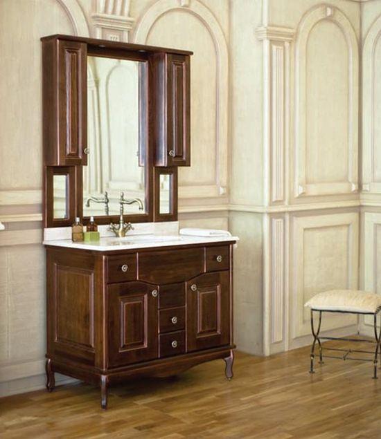 Capan K (D) напольная 100K (D)Мебель для ванной<br>Аллигатор Capan 100K (D). Покрытие трёхслойное влагостойкое, тонированный лак. Столешница из натурального мрамора, фаянсовая раковина Roca или Gustavsberg. Петли со встроенными доводчиками. Размеры тумбы: 1000 x 560 x 850 мм. В комплект поставки входят: тумба, раковина, столешница.<br>
