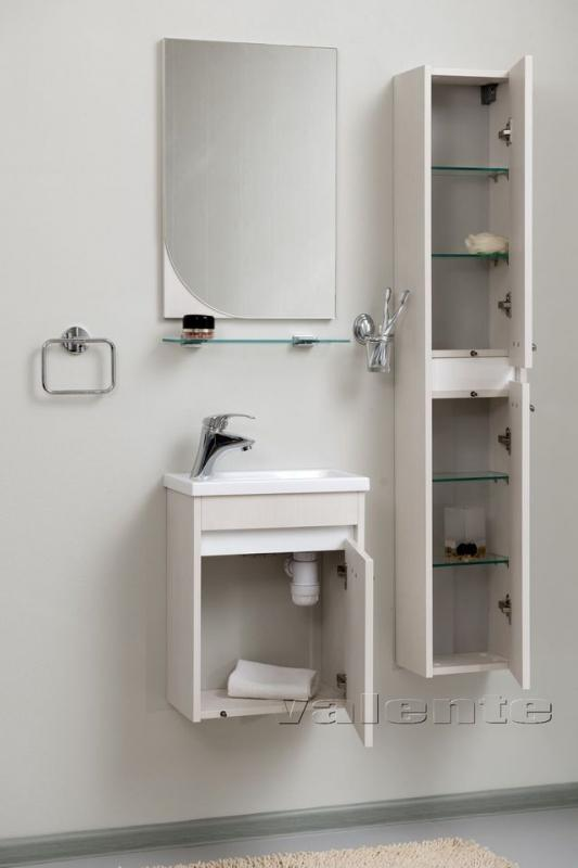 Massima 40 шпон кремовыйМебель для ванной<br>Цена указана за тумбочку с раковиной (шпон кремовый). В нижней части – просторная тумба для разных хозяйственных мелочей, которая очень удачно скрывает трубу. В верхней – раковина прямоугольной формы из прочного и долговечного искусственного камня с системой защиты от перелива. Материал корпуса: влагостойкая ЛДСП высшего качества. Материал фасада: МДФ.<br>