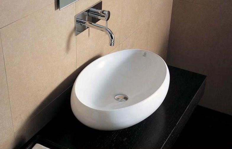 Tao TA 20 БелаяРаковины<br>Hidra Ceramica Tao TA 20. Накладная раковина, устанавливается на столешницу или мебел, цвет: белый. Дополнительно можно приобрести сифон, слив и комплект креплений.<br>