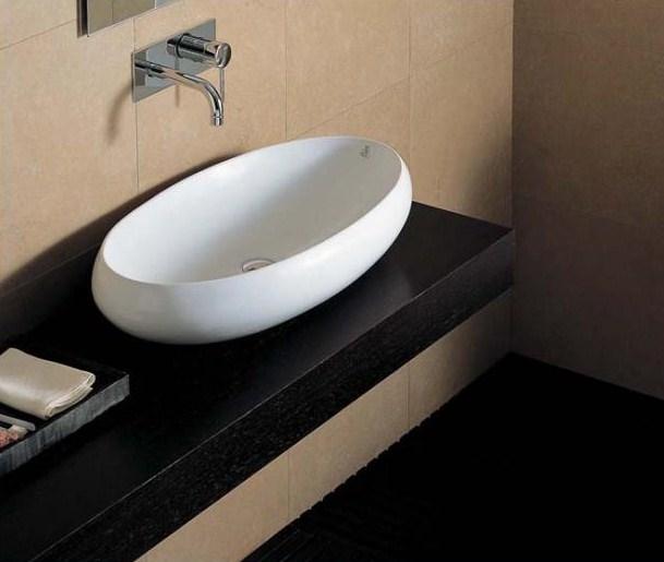 Tao TA 21 ЧернаяРаковины<br>Hidra Ceramica Tao TA 21. Накладная раковина, устанавливается на столешницу или мебел, цвет: черный. Дополнительно можно приобрести сифон, слив и комплект креплений.<br>