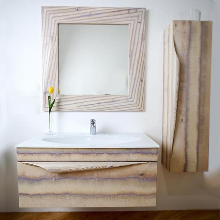 Папирус Wood 100 подвесная Светлое деревоМебель для ванной<br>Подвесная тумба под раковину Aqwella Папирус Wood 100 Pap-w.01.10/LIGHT в цвете светлого дерева, воригинальном иинтересном стиле, с двойным выдвижным ящиком, для использования в ванных комнатах с повышенной влажностью. <br>Уникальная технология обработки: открываются все переходы слоев дерева.<br>Ручная работа мастеров.<br>Изящная форма ручек, подчеркивающая изысканность ибезупречность.<br>Удобное иэргономичное внутреннее пространство.<br>Материал фасада и корпуса: натуральное дерево.<br>Материал ящиков: высококачественная фанера.<br>Выдвижные элементы и навесы Blum: надежность идолговечность.<br>Максимальная нагрузка на выдвижные части: 40 кг.<br>Монтаж: подвесной, крепление к стене.<br>Отделения:<br>основной ящик: три отсека;<br>внутренний ящик: два отсека;<br>система полного выдвижения и мягкого закрывания (Blum).<br>В комплекте поставки:<br>тумба.<br>