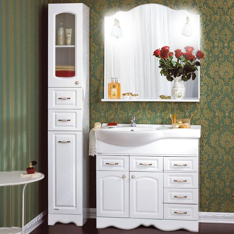 Анна 90 левая БелаяМебель для ванной<br><br>Напольная тумба под раковину Бриклаер Анна 90 левая, с двумя распашными дверцами и с шестью выдвижными ящиками. Для использования в ванных комнатах с повышенной влажностью.<br><br><br>Гармония, домашний уют, тепло и функциональность.<br>Белоснежный рельефный фасад.<br>Изысканная золотисто-фарфоровая фурнитура.<br>Материал корпуса: ЛДСП белый глянец.<br>Материал фасада: МДФ.<br>Повышеная влагостойкость.<br>Необходимо бережное обращение, защита от заливов и протечек воды.<br><br><br>Отделения:<br>правое: четыре выдвижных ящика.<br>левое верхнее: два выдвижных ящика.<br>левое нижнее: две распашные дверцы, одна полка.<br>Металлические направляющие для ящиков.<br><br><br>В комплекте поставки:<br>тумба.<br><br>