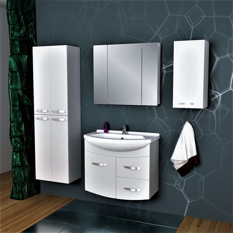 Eco Alfa 75 подвесная Белый лакМебель для ванной<br>Тумба под раковину Dreja Eco Alfa 75 99.0303 подвесная.<br>Превосходно сочетается с интерьером ванной комнаты в современном стиле. Отличается лаконичным дизайном, белой глянцевой поверхностью и несложным монтажом. Может использоваться в условиях повышенной влажности.<br>Габариты корпуса тумбы: 74 х 53,5 х 34,6 см.<br>Материал фасада: влагостойкая МДФ.<br>Материал корпуса: влагостойкая ЛДСП.<br>Защитное покрытие: глянцевая эмаль.<br>Фурнитура: направляющие с доводчиком Hettich (Германия) для плавного и бесшумного закрытия.<br>Подвесная установка с креплением на стену.<br>Комплектация: 2 ящика, 1 дверца, крепления.<br>