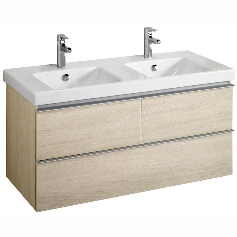 Odeon Up 120 подвесная Светлый дубМебель для ванной<br>Тумба под раковину Jacob Delafon Odeon Up EB892RU-E5 шириной 120 см с тремя выдвижными ящиками.<br>Превосходно сочетается в интерьере любой ванной комнаты в стилистике современного дизайна. Предназначена для использования в условиях повышенной влажности.<br>Тумба отличается исключительным, продуманным до мелочей дизайном, эстетичностью и долговечностью.<br><br>Цвет: Светлый дуб.<br>Габариты корпуса тумбы (ШхВхГ): 117 х 53 х 48,5 см.<br>Тумба выполнена из влагостойкой ЛДСП.<br>Три вместительных ящика.<br>Фурнитура: доводчики с механизмом плавного закрывания и удобные оригинальные ручки.<br>Установка подвесная.<br><br>В комплекте поставки:<br>Тумба.<br>Крепления.<br>Инструкция.<br>