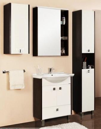 Крит 60 Н белый/венгеМебель для ванной<br>Тумба под раковину Акватон Крит 60 Н 1A151501KT500 на двух ножках, с двумя распашными дверцами и одним выдвижным ящиком. Фасад украшен узорами в стиле древнегреческого орнамента. Корпус выполнен из ДСП с ламинированным покрытием, обладает повышенной влагостойкостью и сопротивляемостью износу, не выделяет вредных испарений, хорошо выдерживает воздействие бытовых химических средств, за исключением абразивных материалов и едких веществ, и жидкостей. Фасадные детали изготавливаются из МДФ с пятислойной покраской.<br>